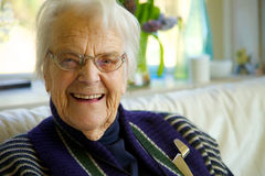 Elderly woman looking at the camera and smiling Royalty Free Stock Photos