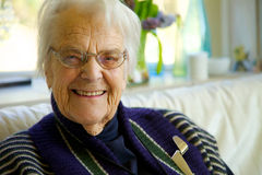 Elderly woman looking at the camera and smiling Royalty Free Stock Photo