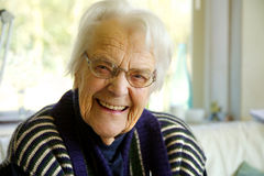 Elderly woman looking at the camera and smiling Stock Photos