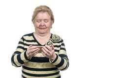 Elderly woman looking at a smart phone Royalty Free Stock Images