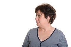 An elderly woman looks away. Stock Photos