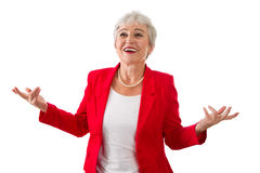 Elderly woman makes decision - Stock Photo. Happy isolated senior businesswoman in a red jacket isolated on white Royalty Free Stock Photo
