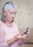 Elderly woman makes testing high blood sugar. Royalty Free Stock Images