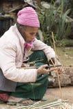 Elderly Woman Making Baskets Royalty Free Stock Image