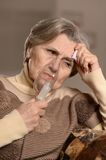 Elderly woman making inhalation Royalty Free Stock Photos