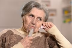 Elderly woman making inhalation Royalty Free Stock Image