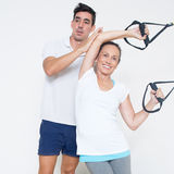 Elderly woman making sling training exercise royalty free stock photography