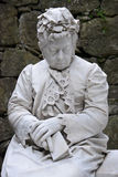 Elderly woman of marble. Sculpture of elderly woman saddened by the loss of a relative Royalty Free Stock Images