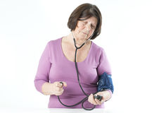 Elderly woman measuring arterial pressure. Stock Image