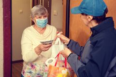 Delivery of food to an elderly woman at home in quarantine