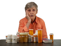 Elderly woman with medications Royalty Free Stock Photography