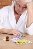 Elderly woman with medicine Royalty Free Stock Image