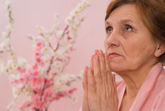 Elderly woman meditating Stock Photography