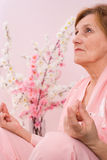 Elderly woman  meditating Stock Photos