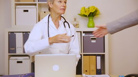 Elderly woman meeting doctor in office stock video footage