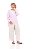 Elderly woman mobile Stock Images