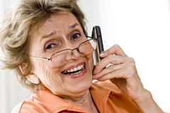 Elderly woman on mobile phone Stock Images