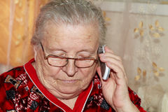Elderly woman and mobile phone Stock Image
