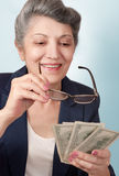 An elderly woman with money Royalty Free Stock Photography
