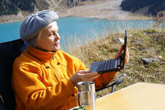 An elderly woman in the mountains Royalty Free Stock Photos