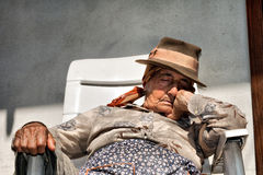 Elderly woman napping Royalty Free Stock Image
