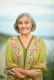 Elderly woman near lake Royalty Free Stock Photography