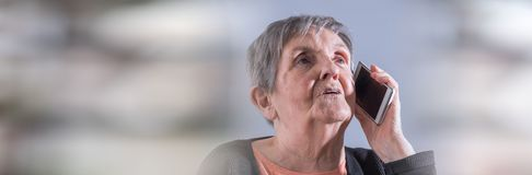Elderly woman and new technologies. panoramic banner royalty free stock image