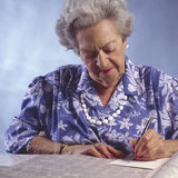 Elderly woman with newspaper classified section#2 Stock Images
