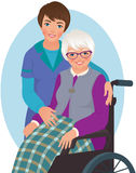 Elderly woman and nurse Stock Image