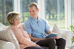 Elderly woman and nurse Royalty Free Stock Photos