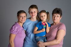 Elderly woman with older daughter and grandchildren. In a studio royalty free stock photo