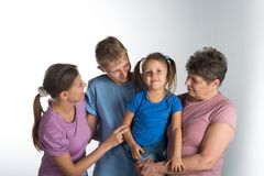 Elderly woman with older daughter and grandchildren. In a studio royalty free stock images