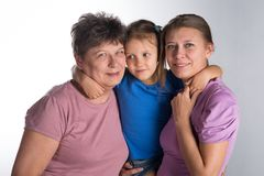Elderly woman with an older daughter and granddaughter. In the studio stock image