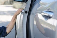 Elderly woman open door car stock photography