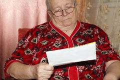 Elderly woman and open letter royalty free stock photography