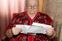 Elderly woman and open letter Stock Photo