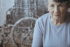 Elderly woman with osteoporosis Royalty Free Stock Images