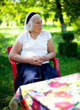 Elderly woman outdoors Royalty Free Stock Image