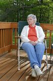 Elderly woman outdoors stock images