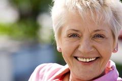 Elderly woman outside stock photos