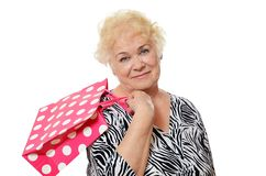 The elderly woman with a package Royalty Free Stock Photography
