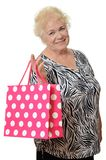 The elderly woman with a package Stock Image