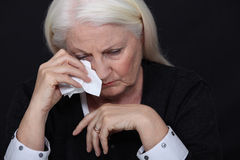 Elderly woman in pain. Is crying Royalty Free Stock Photography