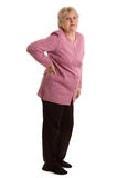 The elderly woman with a pain in a back Stock Images