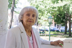 Elderly woman in park. 83 years old royalty free stock photo