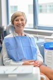 Elderly woman patient at dental surgery checkup Stock Photos