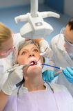 Elderly woman patient open mouth dental checkup Stock Photography