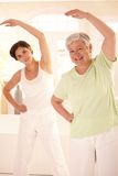 Elderly woman with personal fitness trainer Stock Photo