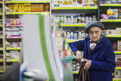 Elderly woman in a pharmacy Royalty Free Stock Images
