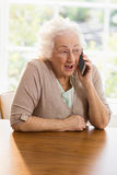 Elderly woman phone calling Stock Image